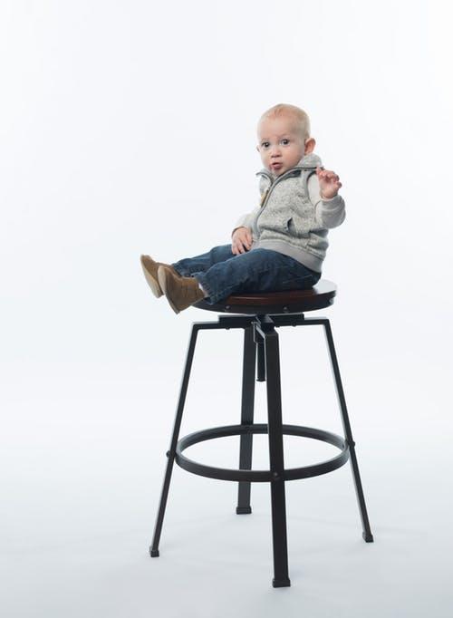 little guy on stool